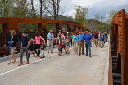 crowd walks across new azalea road bridge