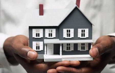 house in hands photo illustration