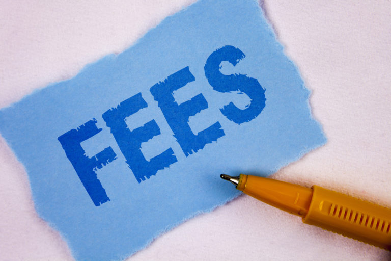 Text sign showing Fees.